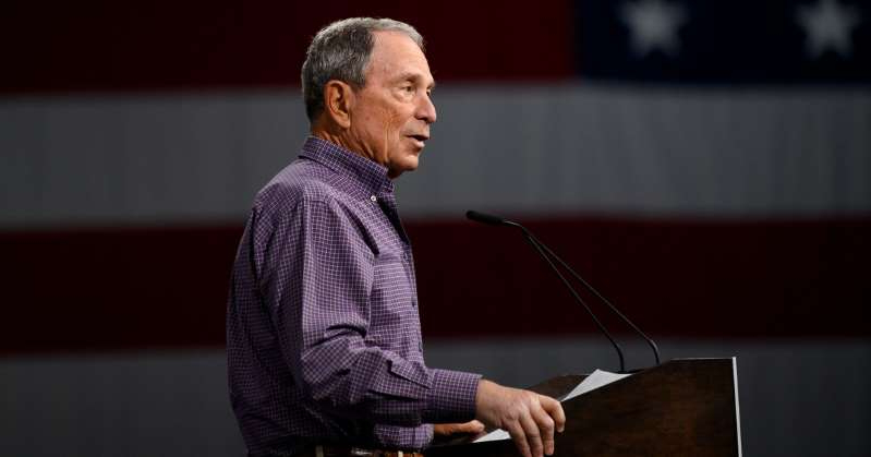 Michael Bloomberg holding a laptop: Let a thousand centrist candidates bloom(berg). Stephen Maturen/Getty Images