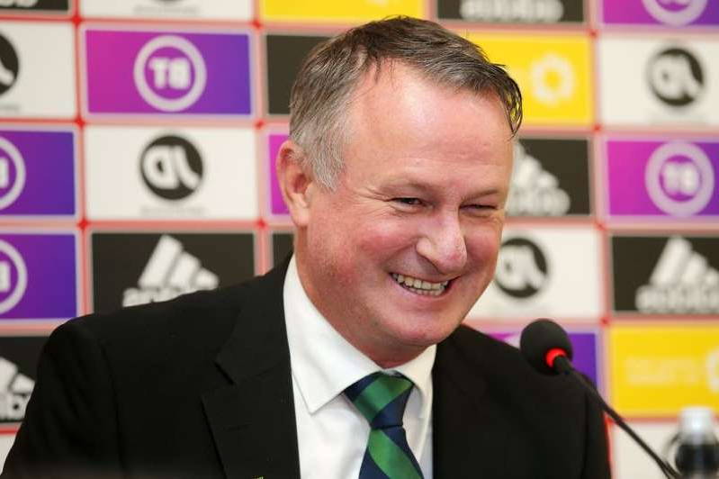 Michael O'Neill wearing a suit and tie: Michael O'Neill