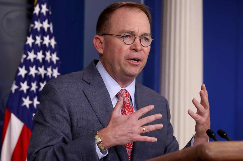 Mick Mulvaney wearing a suit and tie: Acting White House Chief of Staff Mick Mulvaney.
