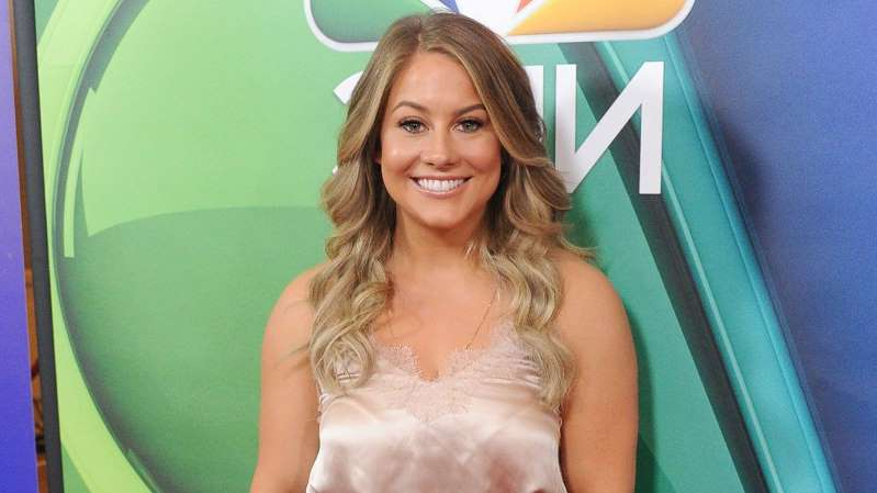 Shawn Johnson wearing a white shirt