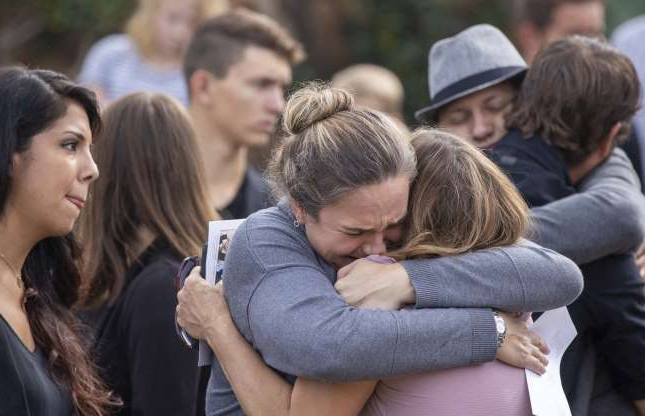 Slide 1 of 38: Family members and friends console each other while they attend the funeral for Dawna Ray Langford and her two children Trevor, 9, and Rogan, 7, on Nov. 7, 2019. They were ambushed by gunmen in Sonora, Mexico.