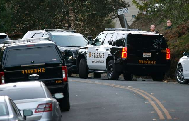 Slide 2 of 3: Sheriffs deputies stand by while investigators continue to collect evidence from a home on Lucille Way in Orinda, Calif. on Friday, Nov. 1, 2019 after four people were killed and several left injured in a shooting during a Halloween party Thursday night.