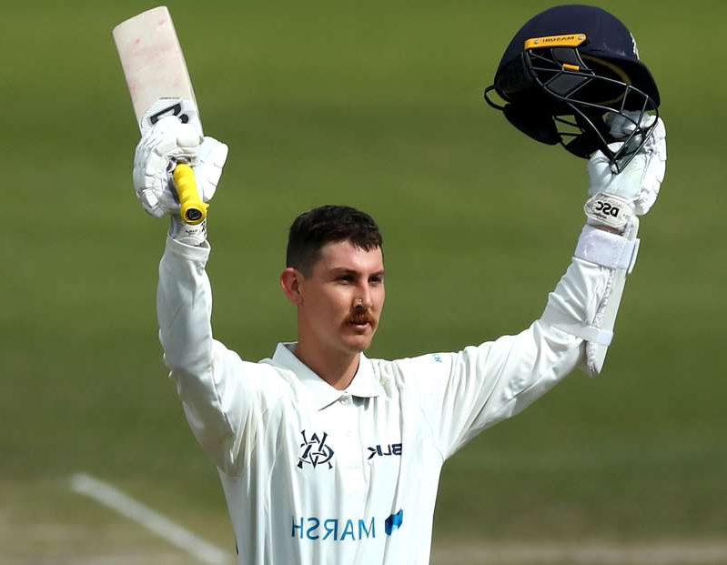 a baseball player throwing a ball: Nic Maddinson celebrates his century against South Australia.