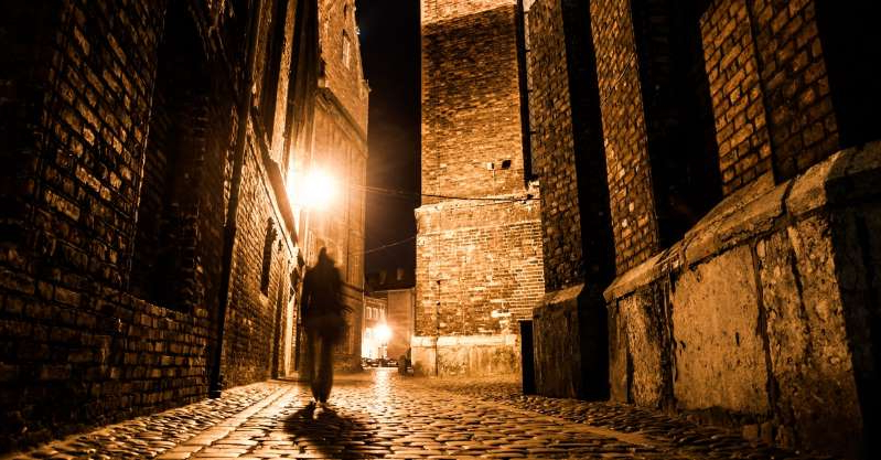 a stone building lit up at night: Have You Ever Wondered Who Jack The Ripper Really Was? We Have The Answer!