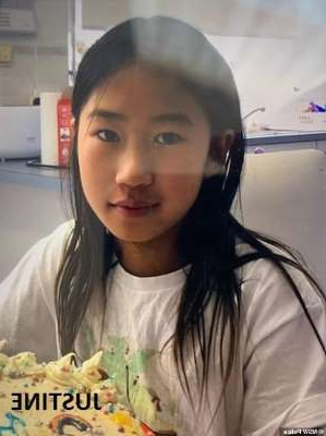 a woman sitting at a table: Justine Zhang (pictured), 12, went missing from a house in Sydney's north on Friday night