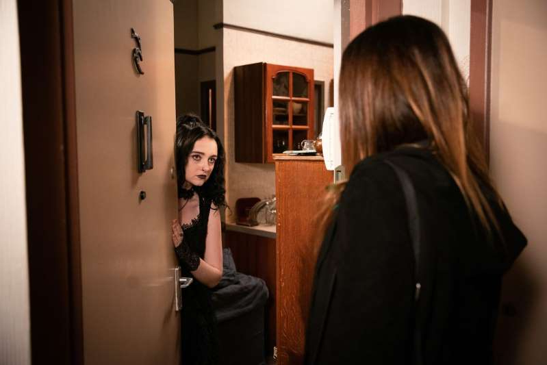 a woman standing in front of a mirror posing for the camera: Carla Connor with Nina in Coronation Street