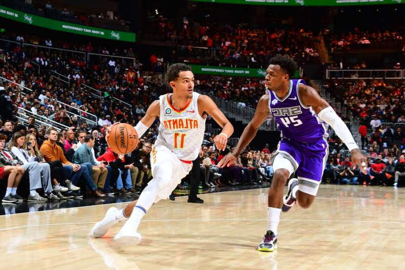 ATLANTA, GA - NOVEMBER 8: Trae Young #11 of the Atlanta Hawks handles the ball against the Sacramento Kings on November 8, 2019 at State Farm Arena in Atlanta, Georgia.  NOTE TO USER: User expressly acknowledges and agrees that, by downloading and/or using this Photograph, user is consenting to the terms and conditions of the Getty Images License Agreement. Mandatory Copyright Notice: Copyright 2019 NBAE (Photo by Scott Cunningham/NBAE via Getty Images)