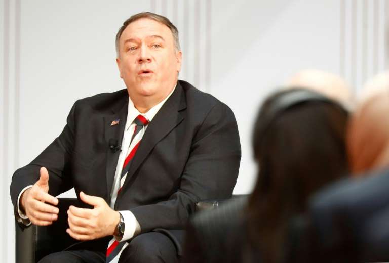 Mike Pompeo wearing a suit and tie talking on a cell phone: US Secretary of State Mike Pompeo said the US was 'alarmed' at Iran's 'lack of adequate cooperation' with UN nuclear watchdog inspectors
