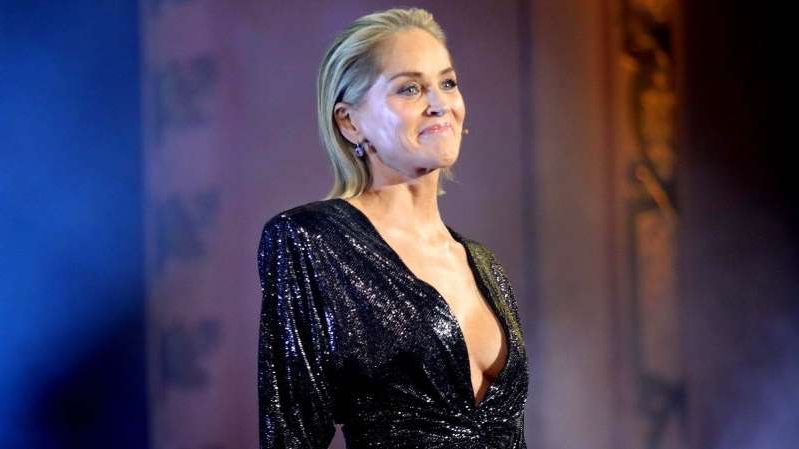 Sharon Stone wearing a black dress
