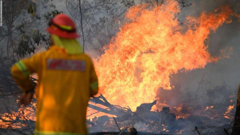 a close up of a fire: Mandatory Credit: Photo by DAN PELED/EPA-EFE/Shutterstock (10470920b) A firefighter works to contain a bushfire near Glen Innes, New South Wales, Australia, 10 November 2019. Three people have reportedly been killed, five are missing and 150 homes have been destroyed as more than 80 bushfires are burning uncontained around the state. At least three dead, thousands evacuated as bushfires continue in New South Wales, Glenn Innes, Australia - 10 Nov 2019
