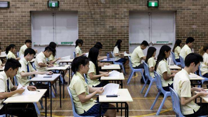 a group of people sitting at a table: Up to 75 per cent of senior students experience ATAR anxiety, data shows.