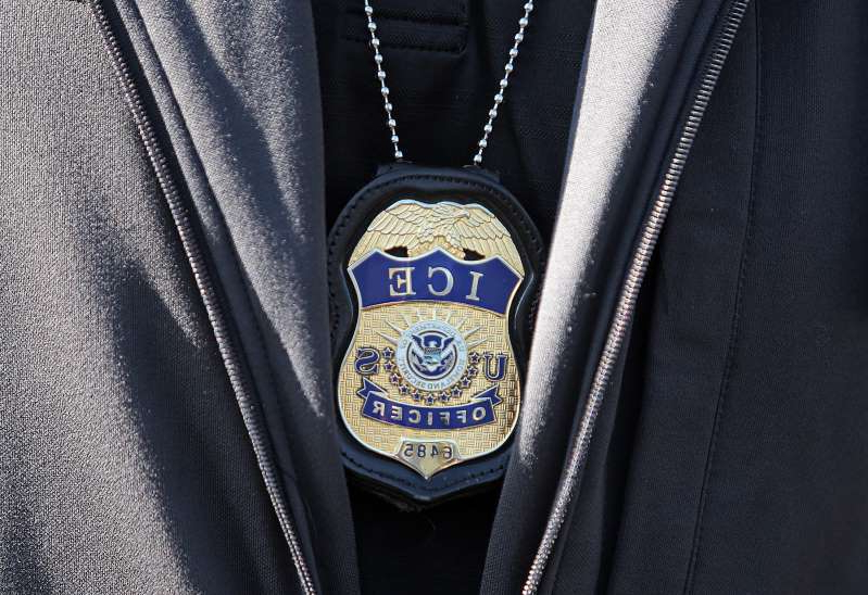a person wearing a suit and tie: REVERE, MA. - SEPTEMBER 25: ICE agent badge on September 25, 2019 in Revere, Massachusetts.  (Staff Photo By Matt Stone/MediaNews Group/Boston Herald)