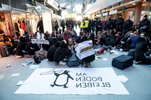 Climate protesters in penguin costumes stage sit-in at Berlin airport