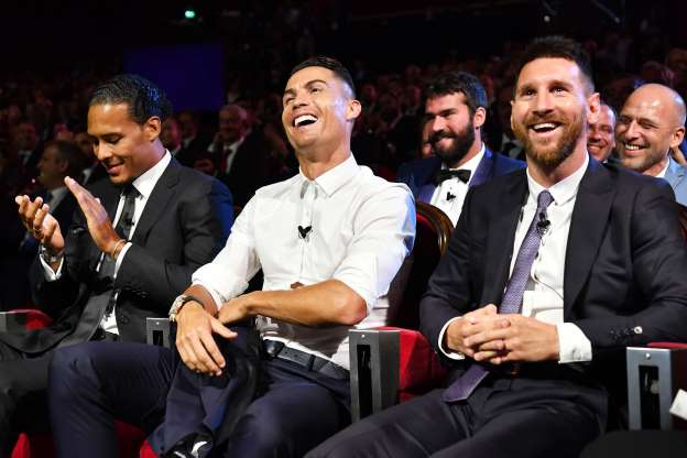 File - MONACO, MONACO - AUGUST 29: Cristiano Ronaldo of Juventus, Lionel Messi of FC Barcelona and Virgil Van Dijk of Liverpool react during the UEFA Champions League Draw, part of the UEFA European Club Football Season Kick-Off 2019/2020 at Salle des Princes, Grimaldi Forum on August 29, 2019 in Monaco, Monaco. (Photo by Harold Cunningham - UEFA/UEFA via Getty Images)