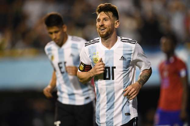 Slide 20 of 25: CAPTION: Argentina's Lionel Messi celebrates after scoring against Haiti during their international friendly football match at Boca Juniors' stadium La Bombonera in Buenos Aires, on May 29, 2018. (Photo by Eitan ABRAMOVICH / AFP) (Photo credit should read EITAN ABRAMOVICH/AFP/Getty Images)