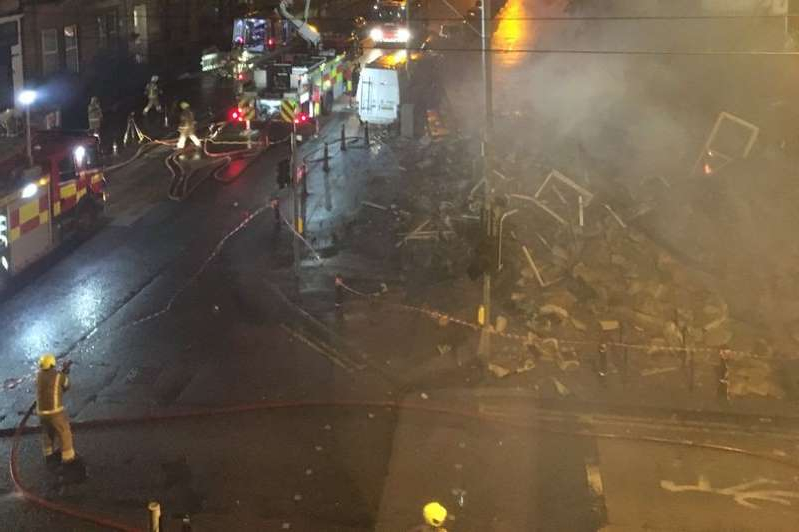a close up of a busy city street at night: The building collapsed at around 5.40am on Monday morning after a large blaze broke out