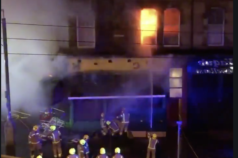 a person on a stage: Fire on lbert Drive in Glasgow