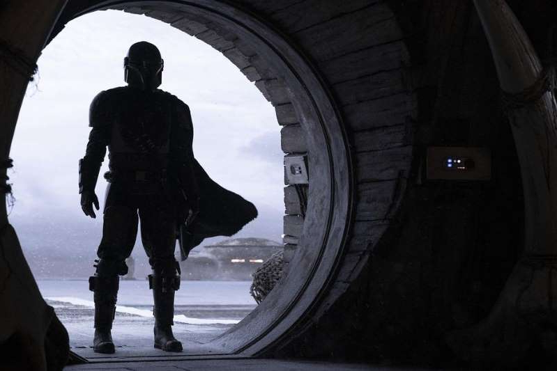 a silhouette of a man: The original shows planned for Disney Plus include a big-budget Star Wars spinoff series, The Mandalorian. François Duhamel/Lucasfilm/Disney Plus