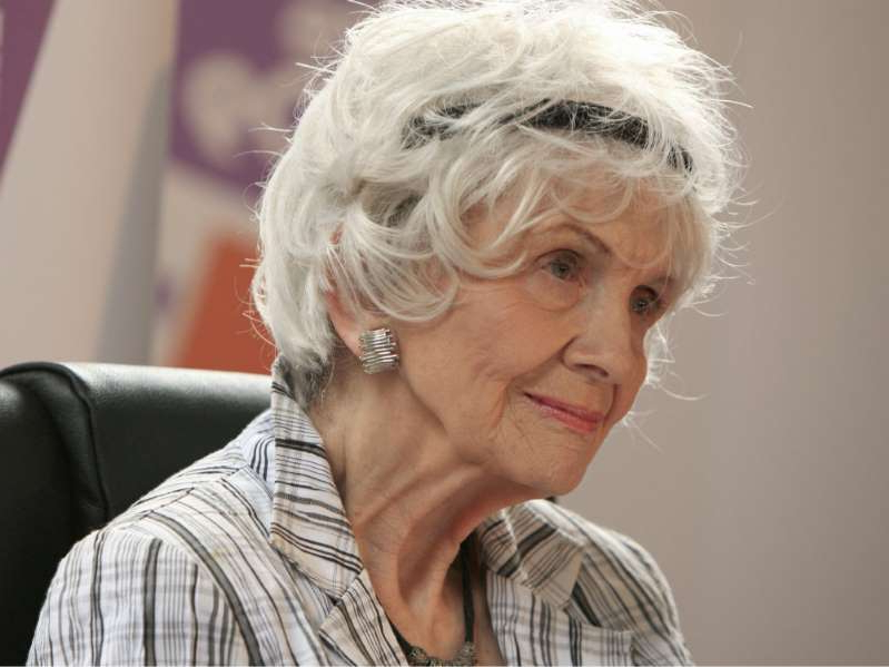 Alice Munro wearing a striped shirt and looking at the camera: Canadian author Alice Munro speaks to the media as she receives her Man Booker International award at Trinity College Dublin, in Dublin, Ireland, on June 25, 2009.