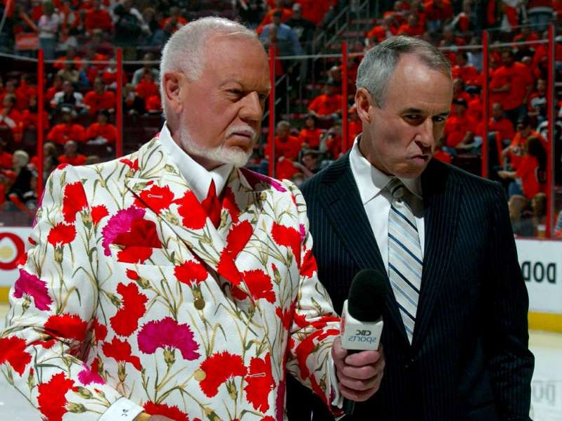 "Don Cherry wearing a suit and tie talking on a cell phone:  The NHL likes to promote Hockey is for Everyone and there's a Hockey Night Punjabi telecast on Saturday nights that was on at the same time Don Cherry (shown right in 2008) was ranting against ""you people"" with his Coach's Corner sidekick Ron MacLean (left) nodding his head in approval and giving a thumbs-up to the anti-immigrant talk, Jack Todd writes. MacLean looked like Sean Spicer when he was supporting Trump as his press secretary before becoming a contestant on Dancing With the Stars."