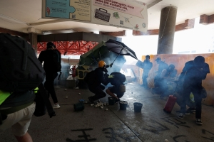 Hong Kong police shoot two pro-democracy protesters