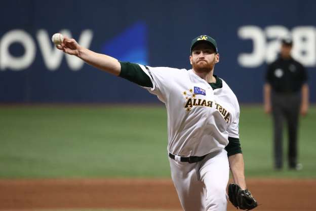 SEOUL, SOUTH KOREA - NOVEMBER 08: Pitcher Jon Kennedy #55 of Australia throws in the top of eighth inning during the WBSC Premier 12 Opening Round Group C game between Australia and Canada at the Gocheok Sky Dome on November 08, 2019 in Seoul, South Korea. (Photo by Chung Sung-Jun/Getty Images)