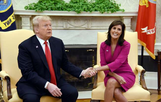 Slide 1 of 17: President Trump shakes hands with Nikki Haley, the United States Ambassador to the United Nations in the Oval office of the White House on Oct. 9, 2018 in Washington, DC. Nikki Haley resigned as the US ambassador to the United Nations, in the latest departure from President Donald Trump's national security team. Meeting Haley in the Oval Office, Trump said that Haley had done a
