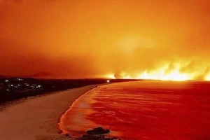 The bay engulfed by fire: Devastating photos taken hours apart show how a picturesque national park has been destroyed by bushfires