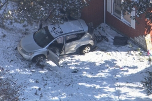 2 suspects in custody after stolen vehicle crashed into North County home