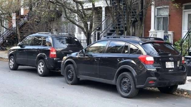 a car parked on the side of a road: SUVs and other highly-polluting vehicles will soon have to pay more for parking permits on Plateau residential streets.
