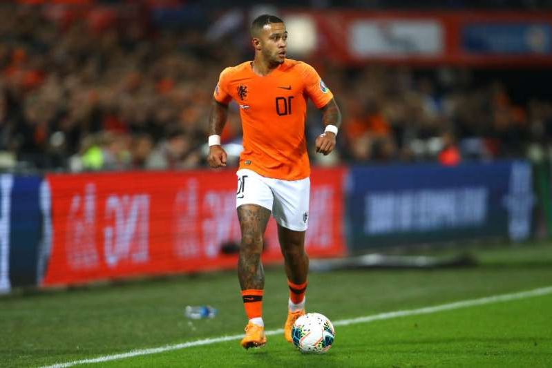 a football player on a field: Spurs readying £50m Depay bid (12th November)