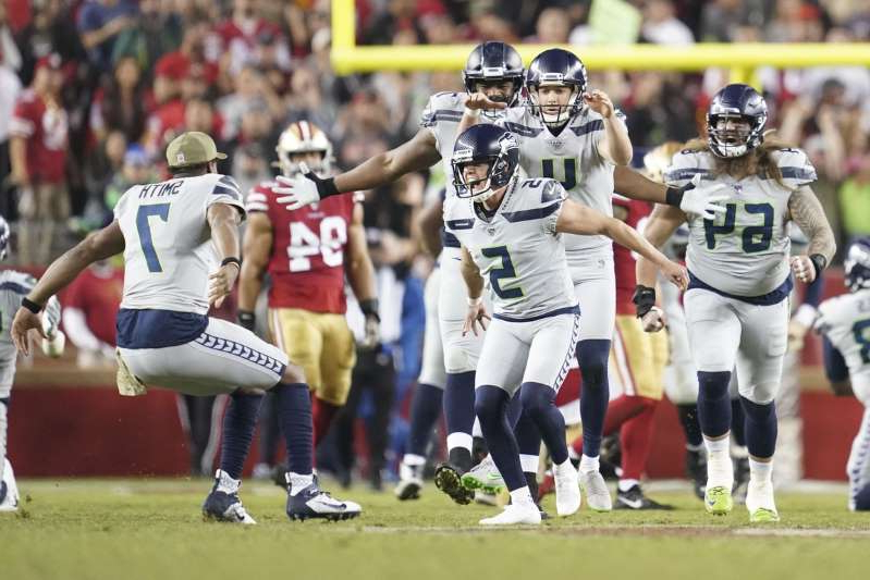 a group of football players on the field: Seattle Seahawks kicker Jason Myers (5) celebrates after kicking the game-winning field goal during overtime against the San Francisco 49ers at Levi's Stadium.