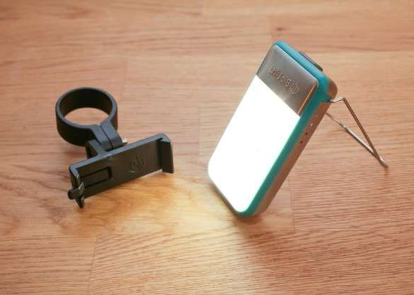 a knife sitting on top of a wooden table: The $40 BioLite PowerLight Mini is a handy lantern, bike light and charger all in one. You clip it to a pocket or strap, or mount it to your bike (mount included), and its 1,350-mAh USB rechargeable battery provides up to 52 hours of light. It can also give your phone a backup boost. Lighting modes include white lantern, red night vision, red and white strobe and white point light. It's a great choice for eco-minded folks who enjoy camping or other outdoor activities.