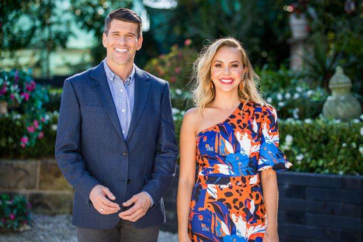 Angie Kent, Osher Günsberg are posing for a picture: Angie, with host Osher, on The Bachelorette.