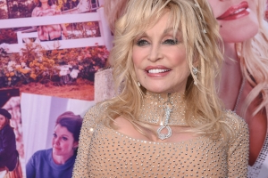 Dolly Parton Opens Up About Her Tattoos: 'I Got Them To Cover Scars'