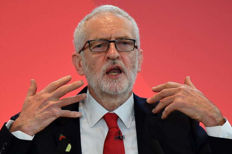 Jeremy Corbyn wearing a suit and tie: Britain's Labour Party leader Jeremy Corbyn launches the party's election campaign in south London on October 31, 2019. Many Jews are concerned about a Corbyn-led Labour government because of the party's anti-Semitism problem.