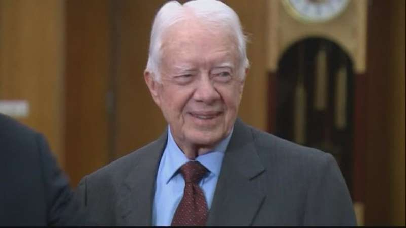 Jimmy Carter wearing a suit and tie
