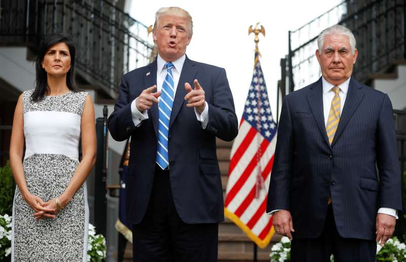 Rex Tillerson, Donald Trump, Nikki Haley are posing for a picture: President Trump gestures while speaking following a meeting with Secretary of State Rex Tillerson, left, and U.S. Ambassador to the United Nations Nikki Haley, right, at Trump National Golf Club in Bedminster, N.J., on Aug. 11, 2017.