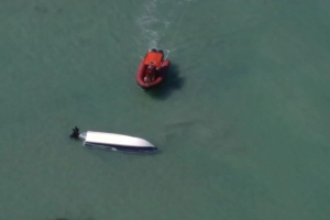 US Coast Guard is searching for two missing boaters after a storm capsized their vessel