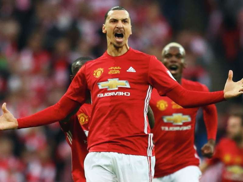 Zlatan Ibrahimovic holding a football ball: Zlatan Ibrahimovic scored 29 goals for Manchester United during a two-year spell at Old Trafford