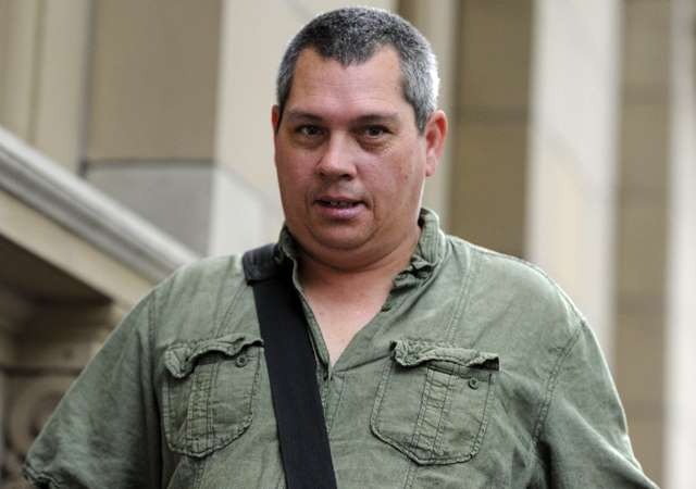 a man smiling for the camera: Black Saturday arsonist Brendan James Sokaluk was found guilty of starting a fire that killed 10 people and destroyed 150 houses in Victoria's east in February 2009.
