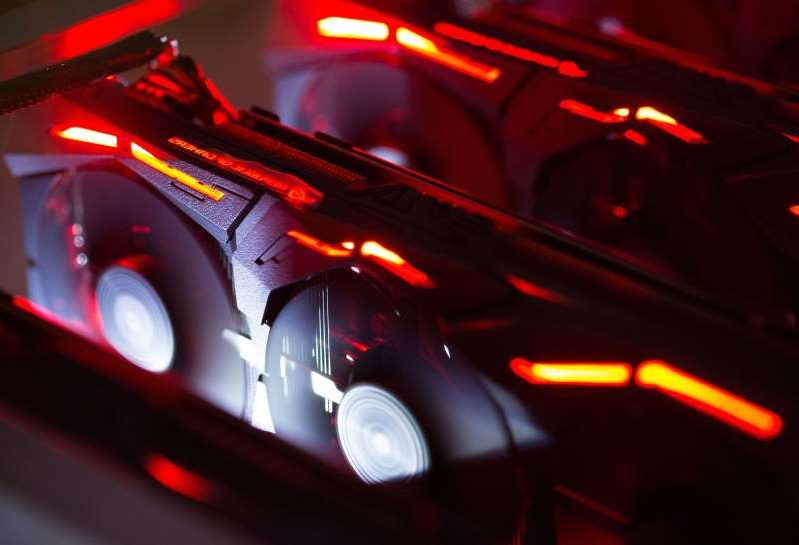 a red car: A cryptocurrency mining rig composed of Asus Strix machines operates at the SberBit mining 'hotel' in Moscow, Russia, on Saturday, Dec. 9, 2017.