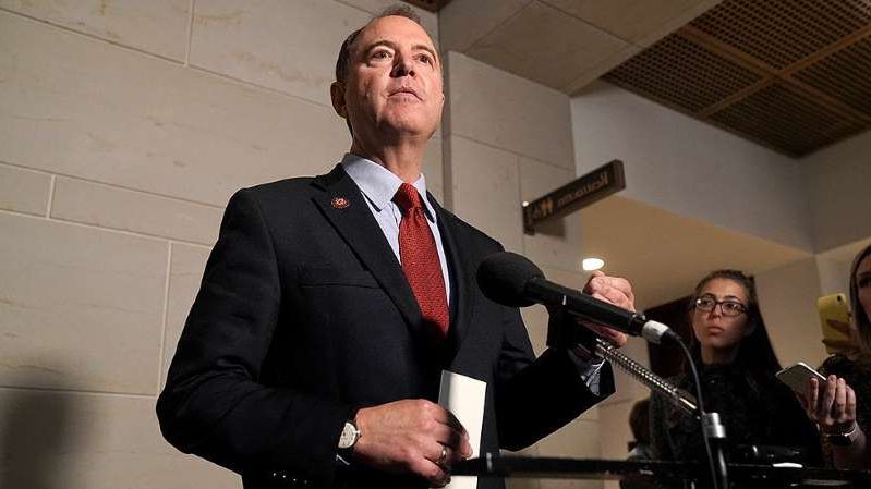 Adam Schiff wearing a suit and tie: House Democrats circulate memo rebutting GOP impeachment defense
