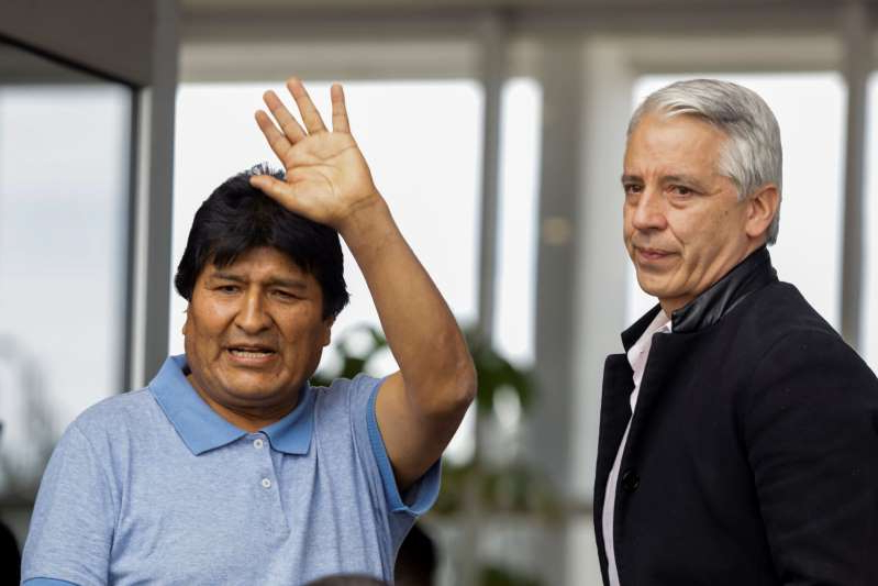 Bolivia's ousted President Evo Morales waves during his arrival to take asylum in Mexico, in Mexico City, Mexico, November 12, 2019. REUTERS/Luis Cortes