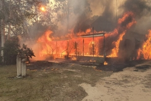 NSW bushfires: Three charged for stealing equipment as police probe 'suspicious' blazes near Sydney