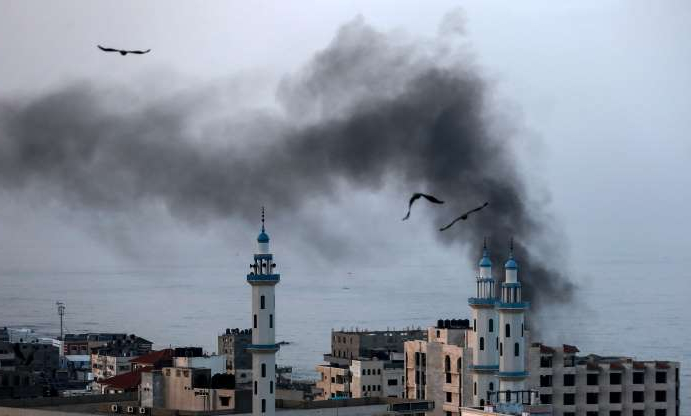 Slide 20 of 120: Smoke rises after an Israeli airstriked in Gaza City on November 13, 2019. - Israel's military killed a commander from Palestinian militant group Islamic Jihad in a strike on his home in the Gaza Strip, triggering exchanges of fire in a violent escalation that left another nine Gazans dead. (Photo by MAHMUD HAMS / AFP) (Photo by MAHMUD HAMS/AFP via Getty Images)