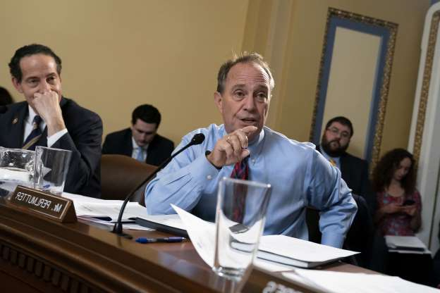 Slide 30 of 85: House Rules Committee members Rep. Ed Perlmutter, D-Colo., and Rep. Jamie Raskin, D-Md., right, work on the markup of the resolution that will formalize the next steps in the impeachment inquiry of President Donald Trump, at the Capitol in Washington, Wednesday, Oct. 30, 2019. Democrats have been investigating Trump's withholding of military aid to Ukraine as he pushed the country's new president to investigate Democrats and the family of rival presidential contender Joe Biden.