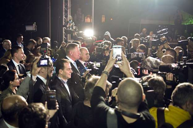 Slide 38 of 120: Romanian President Klaus Iohannis is surrounded by media after exit polls results indicate him as the leader of the presidential race, with up to 40 percent of the votes in Bucharest, Romania, Sunday, Nov. 10, 2019. An election runoff will take place on Nov. 24. (AP Photo/Andreea Alexandru)