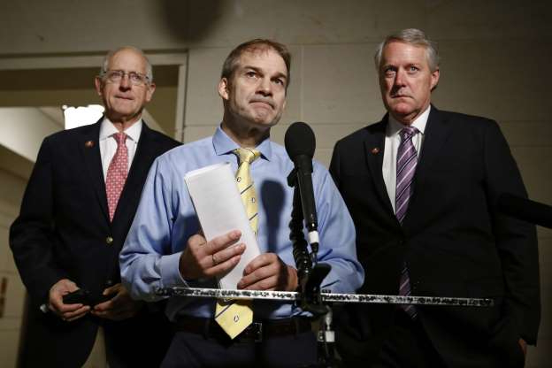 Slide 39 of 85: Rep. Jim Jordan, R-Ohio, center, speaks with members of the media after former deputy national security adviser Charles Kupperman signaled that he would not appear as scheduled for a closed door meeting to testify as part of the House impeachment inquiry into President Donald Trump, Monday, Oct. 28, 2019, on Capitol Hill in Washington. Standing with Jordan are Rep. Mark Meadows, R-N.C., left, and Rep. Michael Conaway, R-Texas.