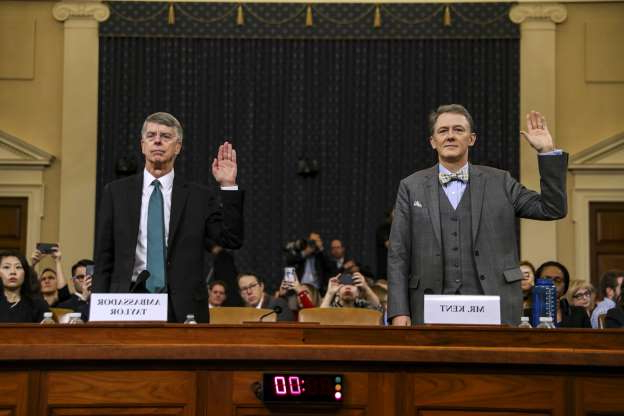 Slide 5 of 85: WASHINGTON, DC - NOVEMBER 13: Deputy Assistant Secretary for European and Eurasian Affairs George P. Kent (L) and top U.S. diplomat in Ukraine William B. Taylor Jr. are sworn in before testifying before the House Intelligence Committee in the Longworth House Office Building on Capitol Hill November 13, 2019 in Washington, DC. In the first public impeachment hearings in more than two decades, House Democrats are trying to build a case that President Donald Trump committed extortion, bribery or coercion by trying to enlist Ukraine to investigate his political rival in exchange for military aide and a White House meeting that Ukraine President Volodymyr Zelensky sought with Trump.